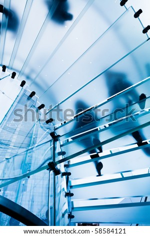 Modern Glass Staircase Silhouette of walking People in shanghai china.