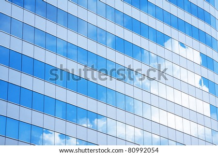 Modern glass with sky reflection