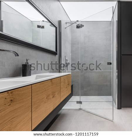 Modern, gray and black bathroom with shower and wooden cabinet #1201117159