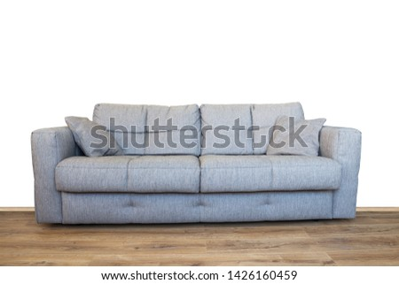Modern gray sofa or couch furniture on wooden floor isolated with white wall background #1426160459