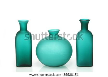 Modern green vases on bright background