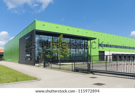 modern green warehouse in the Rotterdam harbor area