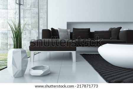 Modern grey and white living room interior viewed low angle over a tiled floor with an upholstered lounge suite , stylish contemporary coffee table and ornamental pot plant in front of large windows