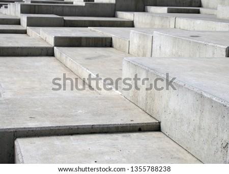 modern grey concrete angular steps in geometric angular shapes on multiple levels