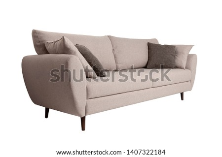Modern grey fabric sofa with pillows isolated on white background. Side view. Strict style furniture #1407322184