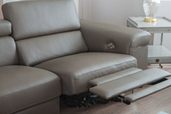 Modern Grey Leather Sofa, with recliner seat in open position.