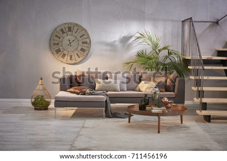 modern grey stone wall luxury living room and interior design with metal stairs #711456196