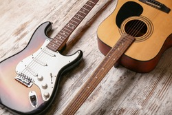 Modern guitars on wooden background
