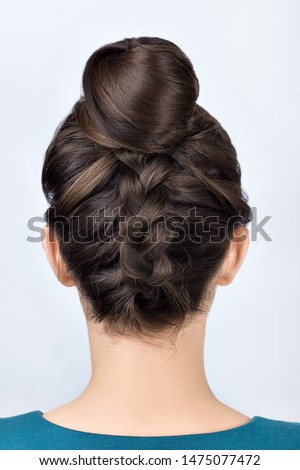 modern hairstyle for long hair reverse braided bun. Upside down french plait