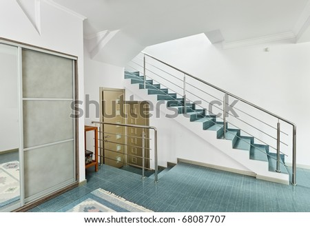 Modern hall with metal staircase interior in minimalism style