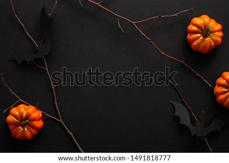 Modern Halloween background with pumpkins, bats, decorations. Halloween party invitation card mockup. Flat lay, top view, copy space.