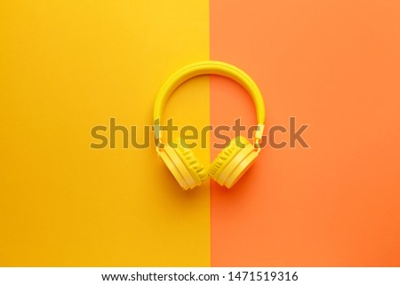 Modern headphones on color background stock photo