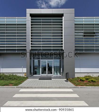 Modern headquarters aluminium building with glass entrance