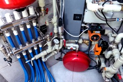Modern heating system in boiler room. Automatic control unit.