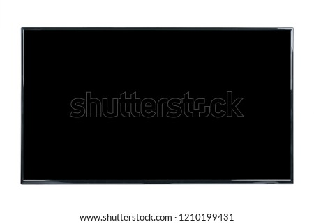 Modern high definition TV. LCD flat monitor with blank black screen, isolated on abstract blurred white background. Technology and 4k television advertising concept. Detailed studio closeup
