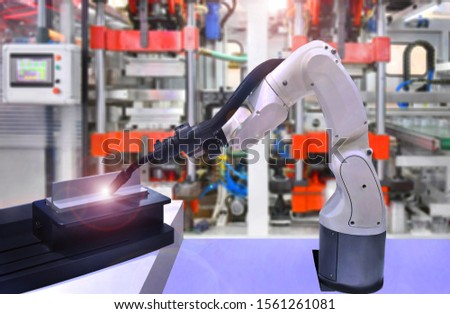 Modern high quality automation welding white robots arm at industrial