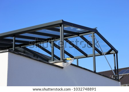 Modern high-quality balcony canopy, terrace canopy - Shutterstock ID 1032748891