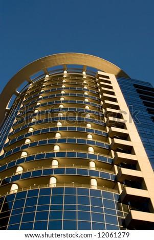 Modern High rise, A tall building against a blue sky.