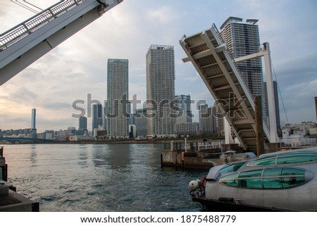 Photo of  Modern high rise buildings beyond the movable bridges