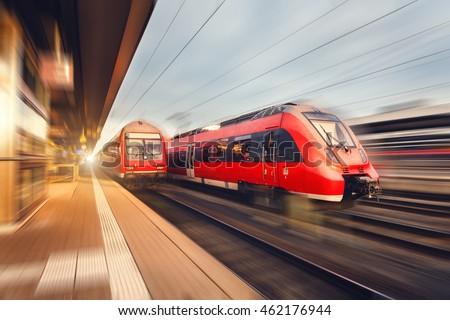 modern high speed red passenger ...