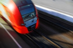 Modern high-speed train in motion, close-up, copy space. Motion Blur. Passenger Transportation