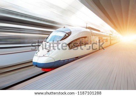 Modern high speed train moves fast along the platform #1187101288