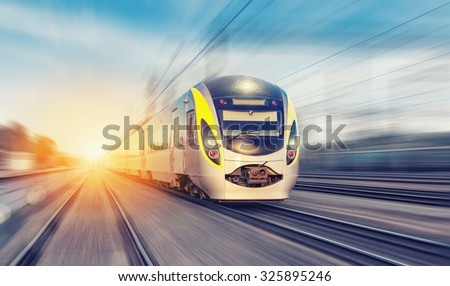 Photo of  Modern high speed train on a clear day with motion blur
