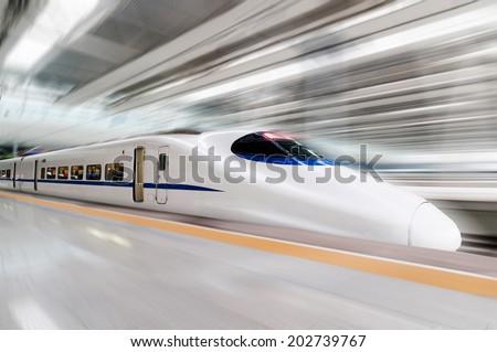 modern high speed train with motion blur #202739767