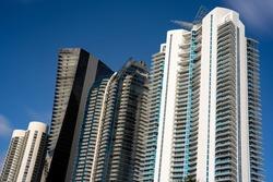 Modern highrise luxury condos in Sunny Isles Beach FL on blue sky USA
