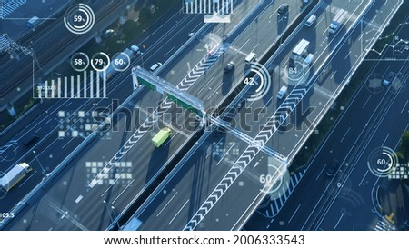 Modern highway aerial view and various charts. Transportation and technology concept. ITS (Intelligent Transport Systems). Mobility as a service.