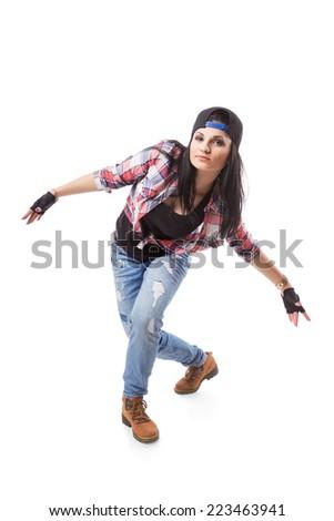 Modern hip-hop dance girl pose on isolated background. Break dance go-go girl standing on white