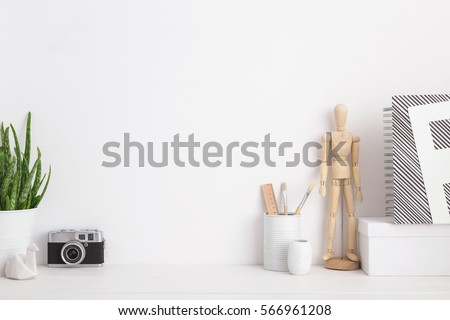 Modern home decor mock up with camera, dummy, houseplant. Artist workspace.