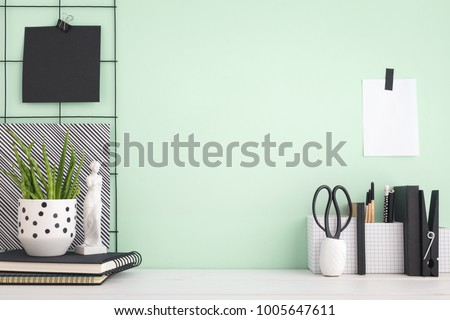 Modern home decor with figurine, stationery, books, plant. Artist workspace with copy space.