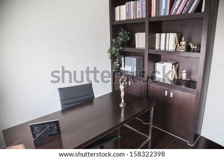 Modern home office with bookshelves and sculptures. #158322398