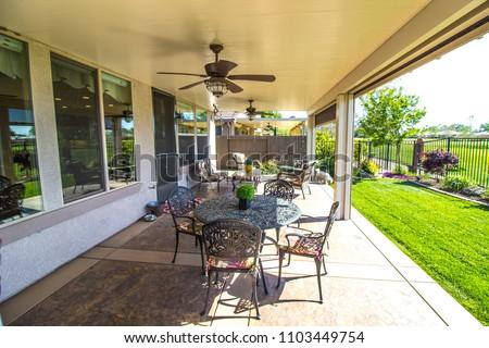Modern Home Rear Yard Patio #1103449754