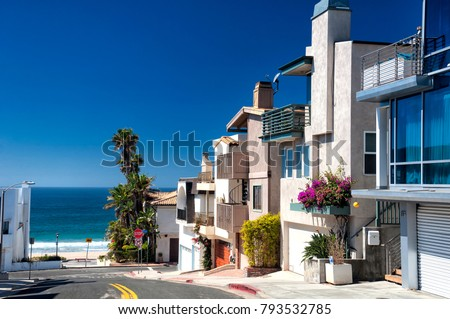 Modern homes lining a street near Manhattan Beach California on a sunny blue sky day.  #793532785