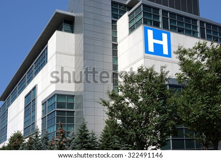 modern hospital building surrounded by trees