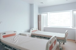 Modern hospital room. Hospital beds in clean and modern hospital