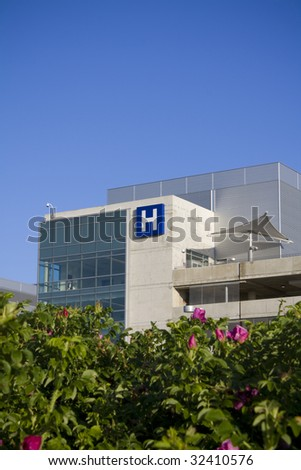 Modern hospital with flowers in foreground