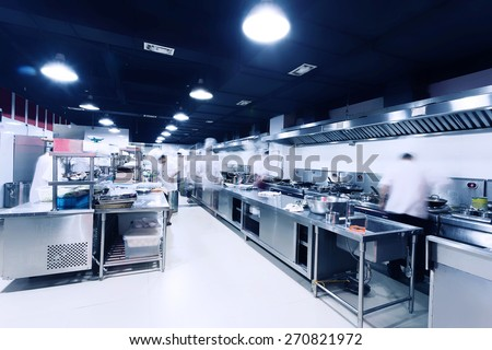 modern hotel kitchen and busy...