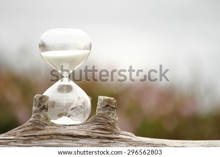 Modern Hourglass -- sand trickling through the bulbs of a crystal sand glass. every second counts. symbol of time. countdown. Time Management. #296562803
