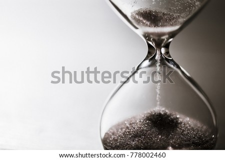 Modern hourglass with bright background for copy space. Hourglass time passing concept for business deadline, urgency and running out of time. #778002460