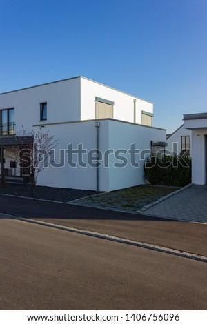 modern house building carport and garage at april spring month in south germany #1406756096