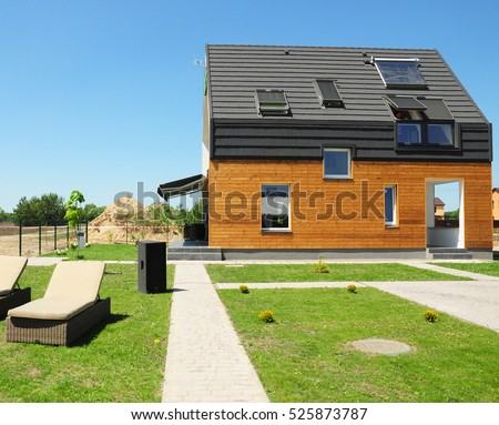 Modern House Construction. Solar water heating (SWH) systems use roof solar panels. Home Skylights, Dormer, Ventilation. Eco Smart House Energy Efficiency.  #525873787