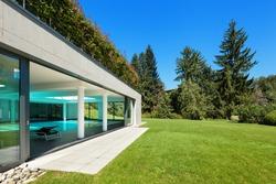 Modern house, garden with indoor pool, outdoors