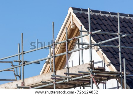 Modern house roof construction with scaffold pole platform. New build domestic building. Сток-фото ©