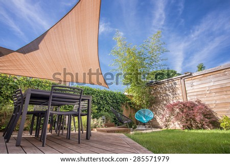 Shutterstock Modern house terrace in summer with table and shade sail