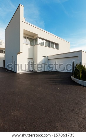 modern house white with garage , view from the courtyard
