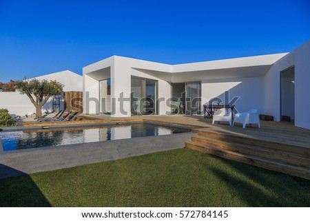 Modern house with garden swimming pool and wooden deck #572784145