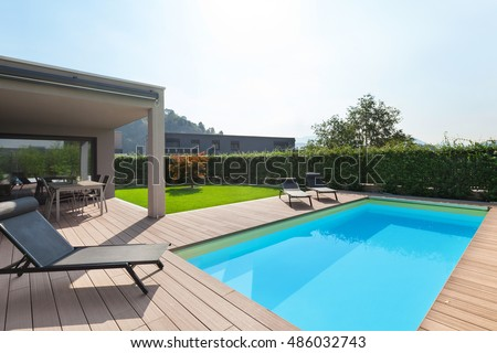 modern house with pool, loungers sun by the pool